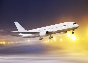 airport and white plane taking off at non-flying weather